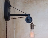 Vintage Industrial Pulley Sconce Lamp. Plug in.