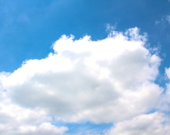 White Fluffy Cloud In A Perfect Blue Sky Print