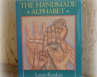 the handmade alphabet book vintage book by laura rankin / manual sign language illustrations