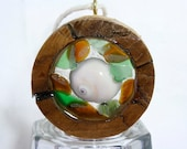 Small hemlock knot round, filled with green and honey amber sea glass and a white snail shell