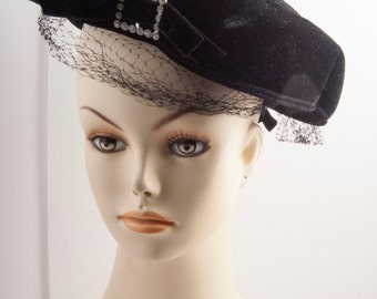 Sculpted black velvet 1960s hat w/ rhinestones, webbing and presence. Elegant, Classy, refined, formal,