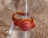 Rapid Red Swirled Wired Wrapped Ring please find this at WhimsicalTreasures2 here on etsy