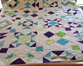 Queen size patchwork quilt. Turquoise, green, and purple sampler quilt.