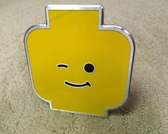Yellow brick head hitch cover