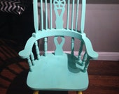 Mint green and yellow distressed arm chair