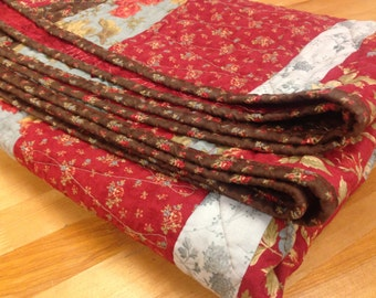 Lap Quilt in Deep Reds, Rich Browns, and Pale Blues using Moda's Double Chocolate