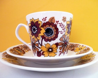 Two Elizabethan Chelsea trios - gold and brown cup, saucer and plate - funky 70s pattern