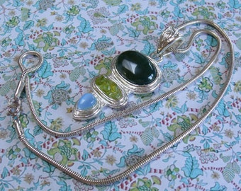 A very fine  triple stone jewelry pendant and chain made in 925 marked silver set with  blue and light and dark green semi precious stones