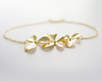 Delicate gold triple orchid flower bracelet