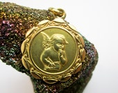 Art Deco 1920s Raphael Angel/ Cherub Pendant, 18K Gold, Floral Spray Border, Hallmarked Italy.