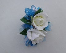 2 Piece wrist corsage and matching boutonniere in aqua