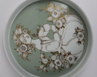 Bjørn Wiinblad Tray / Bowl  with a young woman with a bird in gold made by Rosenthal  studio linie in the mid century - RARE
