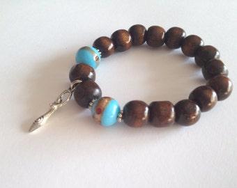 CLEARANCE *** Splendid wood beads bracelet with 2 stylished glass beads and a goddess charm
