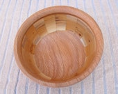 A very attractive segmented bowl made from Scottish yew and reclaimed red oak..