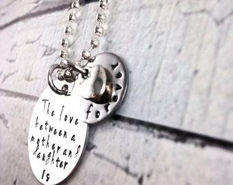 The love between a mother and daughter is forever personalized hand stamped stainless steel necklace