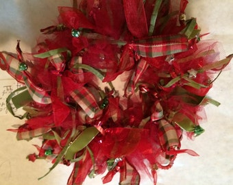Fancy, decorative collar. Red and plaid.