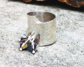 Silver adjustable ring, with small swarovski cristals