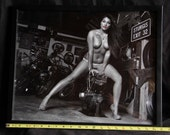 16x20 inch framed poster of a topless beauty in a biker garage