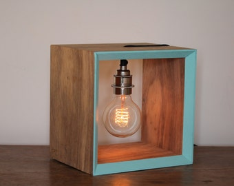 Table lamp or bed side lamp. A ltd edition table lamp with beautiful Edison style bulb, contemporary coloured edge