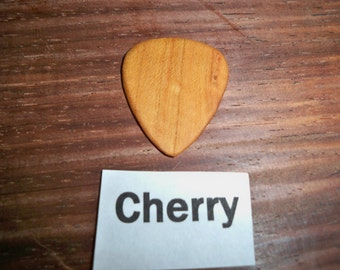 Cherry wood guitar pick