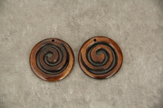 Two Pieces Buffalo Bone Carved Spiral