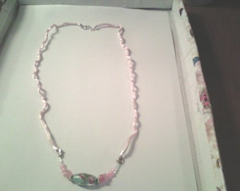 Pink and blue childs necklace.