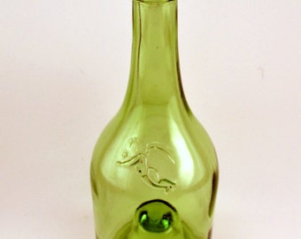 Vintage green champagne bottle with cupid motif