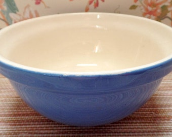 "Vintage Bluebell over ivory ceramic mixing bowl.  It is 4"" tall, and 8"" diameter.  There is no mark."