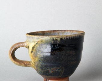 Anagama wood fired tenmoku natural fly ash on stoneware guinomi matcha, fired to cone 13