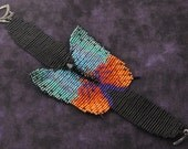 Butterfly Loomed Bracelet.Embellished Body.Brilliant Colors of Teal, Orange and Purple.Toggle Clasp