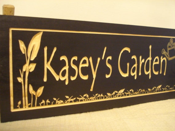 Black Wood Carved Gardening Sign