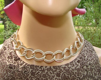 1980's choker necklace.  White enameled links with gold tone metal links.  Perfect for any occasion or with jeans and a tee.