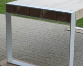 Handmade dining table. Pure contemporary design. Steel and timber.