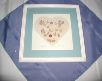 Heart shaped dried flower picture with matt and frame.