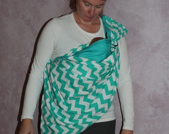 Baby Sling,  great way to keep baby close and loved while you have a free hand to get things done.