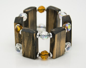 "Wooden bracelet. Reclaimed wood. Recycled. Jewelry. Eco friendly. Elastic bracelet. Stretch. Size: 6 7/8"" (17.5 cm)"