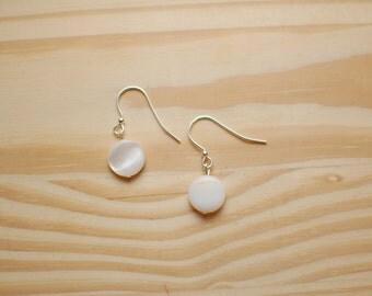 White Beaded Earrings.