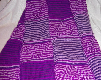 knitted baby blanket in rich lilac colors
