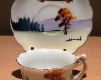 """Vintage 1954 collectible souvenir mini tea cup and saucer commemorating the """"1854-Centennial-1954"""" of the Iowa State Fair. Made in Japan."""