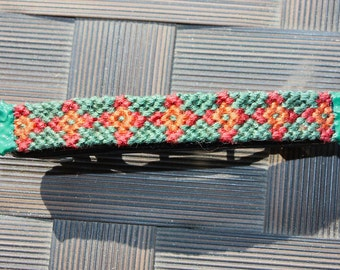 Orange, yellow and green string knotted barrette