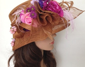 A Golden Brown Sinamay Church Hat With Flowers And Feather