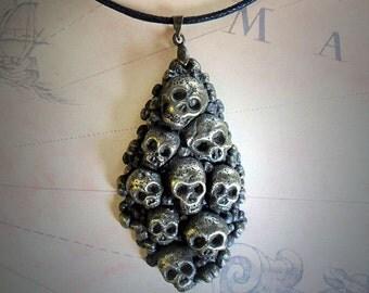 Necklace of Skulls in brass