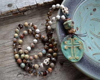 Earthy Bohemian Skull Necklace Stoneware cross pendant Impression jasper layering Rustic pale aqua blue cream brown Hand knotted gemstones