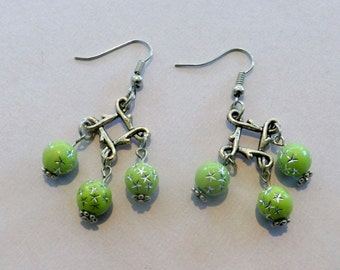 Gorgeous dangle earrings with 3 bright green beads