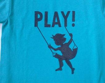 "Custom tee with swinging child & ""Play!"" -"