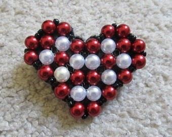 Heart-shaped bead red & white broach