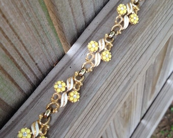 Vintage bracelet signed Cora, yellow white 1970's