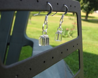 Tiny 6 mm glass square wire-wrapped clear boxy earrings on silver earwires.