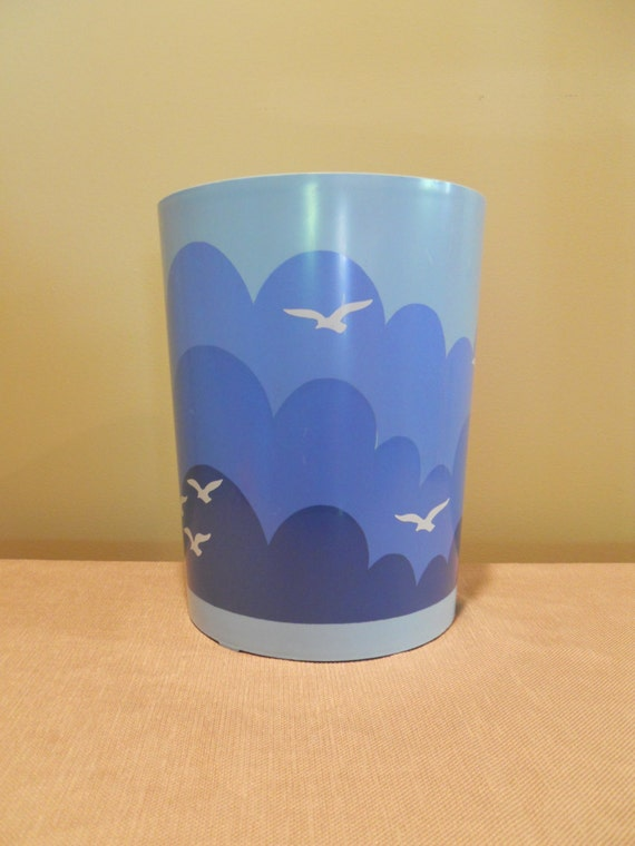 cool retro small blue plastic trash can with beach theme