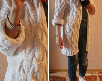 white fashionable jacket, knitted hands